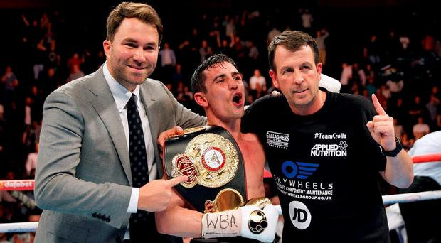 Anthony Crolla celebrates with trainer Joe Gallagher (right) and promoter Eddie Hearn after beating Ismael Barroso in the WBA World Lightweight Title bout at the Manchester Arena.