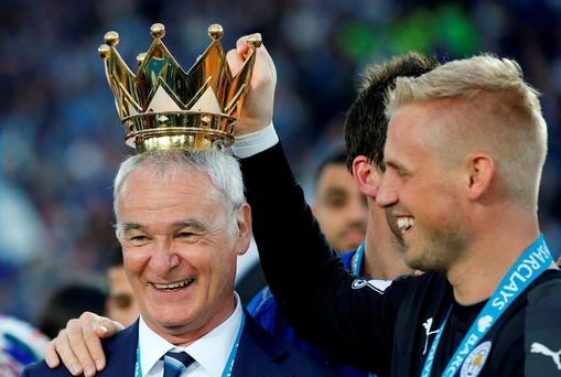 Leicester City manager Claudio Ranieri lifts the trophy with Kasper Schmeichel as they celebrate winning the Barclays Premier League Action Images via Reuters / Carl Recine