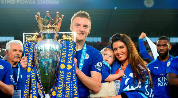 Jamie Vardy of Leicester City poses with the Premier League Trophy with his family after the Barclays Premier League match between Leicester City and Everton at The King Power Stadium