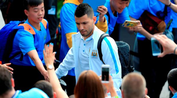 Manchester City's Sergio Aguero greets fans before the Barclays Premier League match at the Etihad Stadium