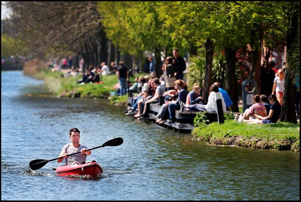Ional Adrian Marginean from South Circular Road Dublin enjoying the sunny weather with his canoe along the canal at Portobello. Photo: Steve Humphreys