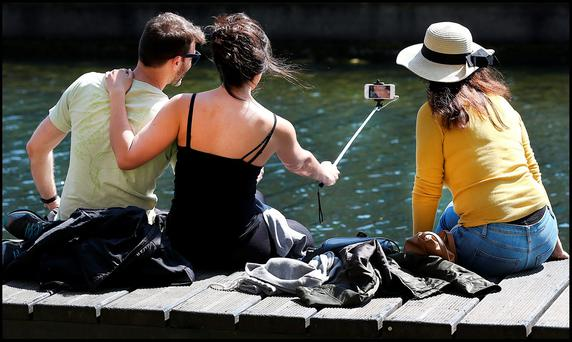 Taking a selfie while enjoying the sunny weather along the canal at Portobello was Leonardo Vega and Renata Migliacci from Rathmines with Renata's visiting Mum Sandra Migliacci from Brazil. Photo: Steve Humphreys