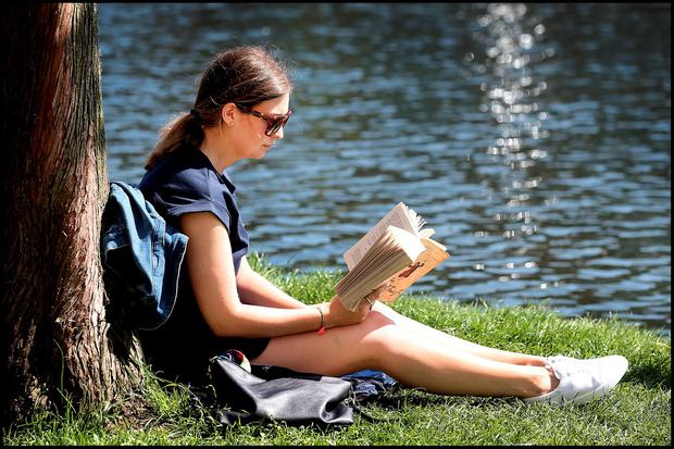 Aine Hussey from Mornington Co Meath reading a book along the canal at Portobello. Photo: Steve Humphreys