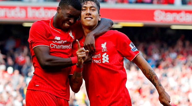 Britain Soccer Football - Liverpool v Watford - Barclays Premier League - Anfield - 8/5/16 Roberto Firmino celebrates with Sheyi Ojo after scoring the second goal for Liverpool Reuters / Phil Noble