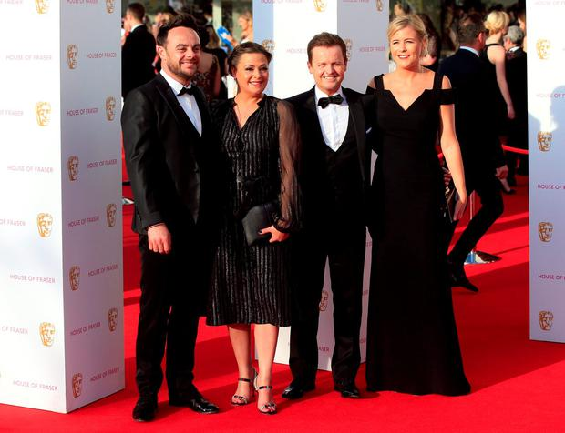Anthony McPartlin and Declan Donnelly aka Ant and Dec with partners Lisa Armstrong and Ali Astall attending the House of Fraser BAFTA TV Awards 2016 at the Royal Festival Hall, Southbank, London.