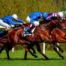In the Godolphin all blue, Moonlight Magic and Kevin Manning (nearest camera) swoops past both Beacon Rock and Saafarr (left) to on his way to claiming yesterday's Derrinstown Stud Derby Trial at Leopardstown. Photo: Seb Daly/Sportsfile