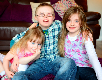 Patrick Kehoe (11) from Dundalk at home with his sisters, Lilly (3) and Kacey (8) Photo: Ciara Wilkinson