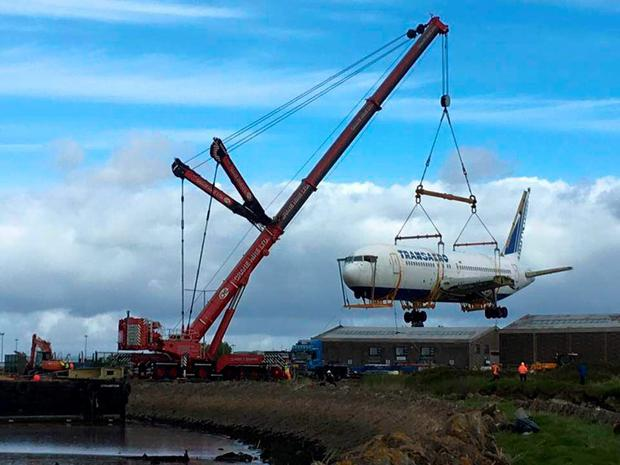 The Boeing being hoisted from its barge and transported to its final resting place, at the Quirky Nights Glamping Village Photo: Sean Harrington, Atlantic Towage and Marine