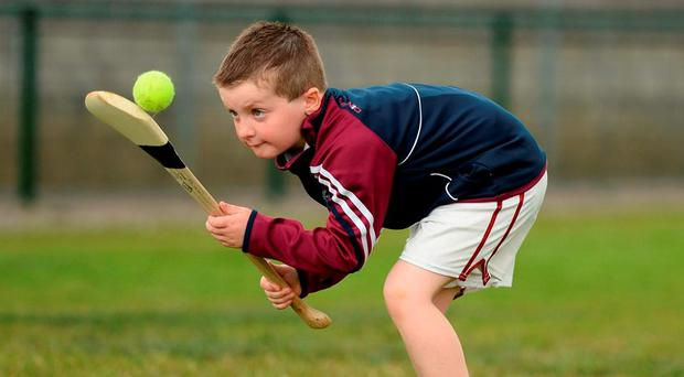 Darragh O'Shea, aged 7, practises his hurling skills during the Piarsaigh Na Dromoda Lá na gClubanna celebrations in Dromid, Co Kerry. Photo: Diarmuid Greene / Sportsfile