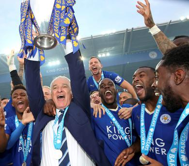 Leicester City manager Claudio Ranieri lifts the Premier League trophy
