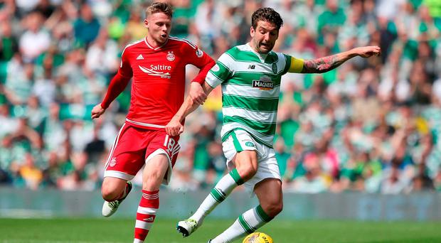 Aberdeen's Simon Church (left) and Celtic's Charlie Mulgrew in action during the Ladbrokes Scottish Premiership match at Celtic Park. Photo: Andrew Milligan/PA