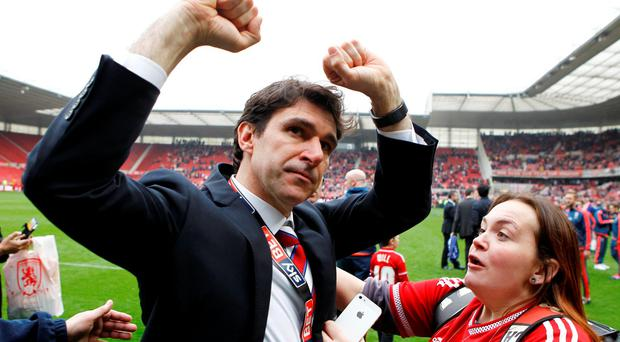 Middlesbrough manager Aitor Karanka celebrates with fans after being promoted to the Barclays Premier League. Photo: Brough/Reuters
