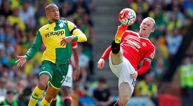 Manchester United's Wayne Rooney attempts to keep the ball away from Norwich's Martin Olsson. Photo: John Sibley/Action Images via Reuters