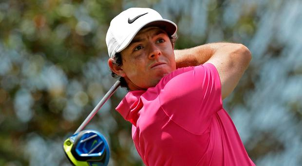 Rory McIlroy watches his tee shot on the 15th hole during the final round of the Wells Fargo Championship golf tournament at Quail Hollow