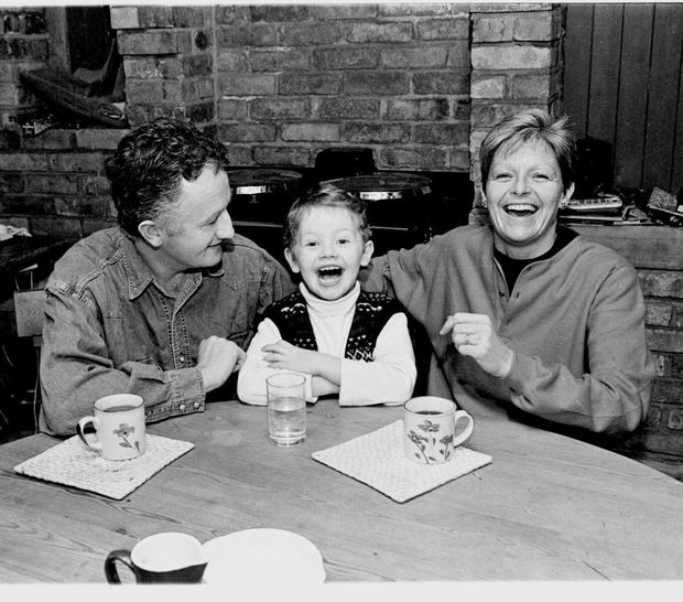 Veronica Guerin pictured with husband Graham and son Cathal at home