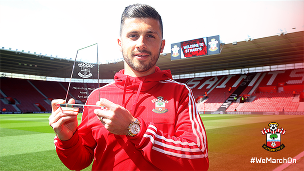 Shane Long poses with his award