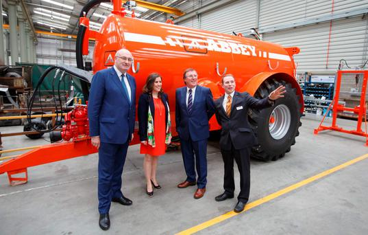 EU Agriculture Commissioner Phil Hogan with Abbey Machinery's managing director Clodagh Cavanagh, former managing director Charles Cavanagh and director Owen Cavanagh at the official opening of the new Abbey Machinery factory in Toomevara. Photo: Alf harvey/HRPhoto.ie