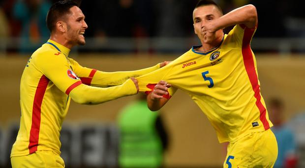 Ovidiu Hoban (R) of Romania celebrates his goal with team mate Florin Andone