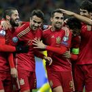 Spain's players celebrate after scoring during the Euro 2016 qualifying football match between Ukraine and Spain