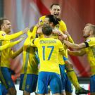 Zlatan Ibrahimovic of Sweden (L) celebrates scoring his first goal with Oscar Lewicki, Andreas Granqvist, Kim Kallstrom, Sebastian Larsson of Sweden