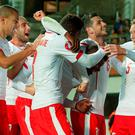 Swiss players reacts after the Euro 2016 Group E qualifying football match between Estonia and Switzerland