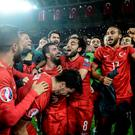 Turkey's National Football Team players celebrate their victory over Iceland during the UEFA Euro 2016 qualifying round Group A soccer match at Torku Arena in Konya