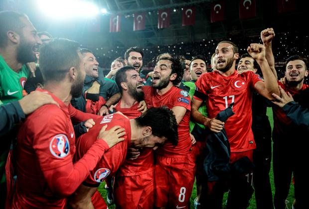 577f7247b Turkey s National Football Team players celebrate their victory over Iceland  during the UEFA Euro 2016 qualifying