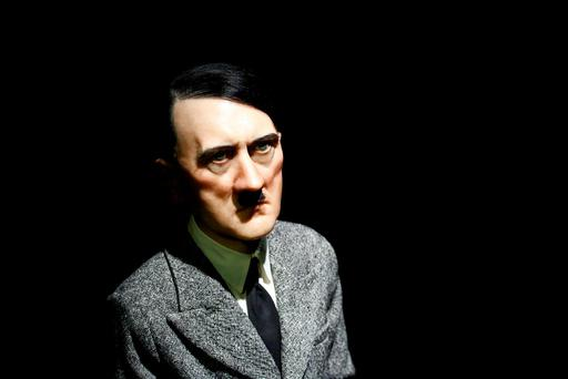 This file photo taken on April 29, 2016 shows the artwork 'Him',depicting Hitler on his knees in prayer by artist Maurizio Cattelan displayed during a press preview in New York