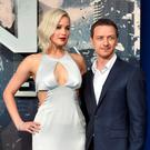 Actor Jennifer Lawrence poses with James MacAvoy at a screening of X-Men Apocalypse at a cinema in London, Britain, May 9, 2016