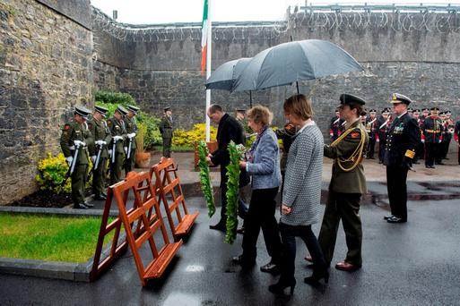 Kathleen Kent, niece of Thomas Kent, and Junior Defence Minister Paul Kehoe lay wreaths at Cork Prison. Photo: Provision