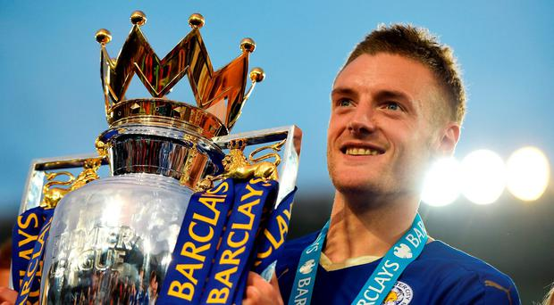 Leicester City's Jamie Vardy poses with the Premier League Trophy. Photo: Getty