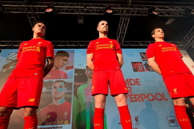 Liverpool's (left to right) Philippe Coutinho, Jordan Henderson and Jon Flanagan during the 2016-17 home kit reveal at the Royal Liver Building, Liverpool. PRESS ASSOCIATION Photo. Picture date: Monday May 9, 2016. See PA story SOCCER Liverpool. Photo credit should read: Barrington Coombs/PA Wire