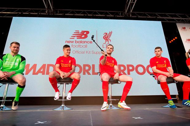 Liverpool's Simon Mingolet, Philippe Coutinho, Jordan Henderson and Jon Flanagan during the reveal of Liverpool's 2016-17 home kit at the Royal Liver Building, Liverpool. PRESS ASSOCIATION Photo. Picture date: Monday May 9, 2016. See PA story SOCCER Liverpool. Photo credit should read: Barrington Coombs/PA Wire