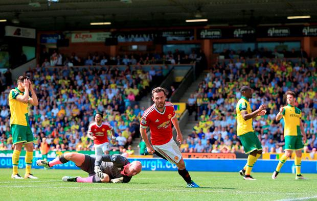 Manchester United midfielder Juan Mata celebrates scoring the winner against Norwich last Saturday. Photo: PA