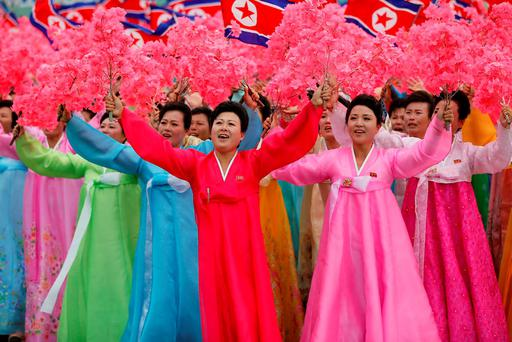 People react as they see North Korean leader Kim Jong Un during a mass rally and parade in the capital's main ceremonial square, a day after the ruling party wrapped up its first congress in 36 years by elevating him to party chairman, in Pyongyang, North Korea. Reuters/Damir Sagolj