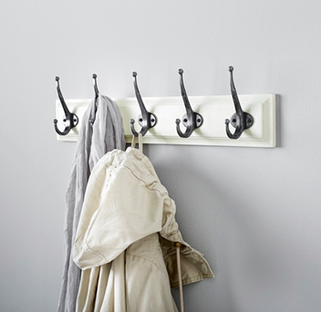 Have some hooks popped along your hallway wall in such a way that they look like a feature of the room.