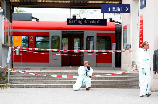 A police officer takes pictures at the train station in Grafing, Germany. Reuters/Michaela Rehle