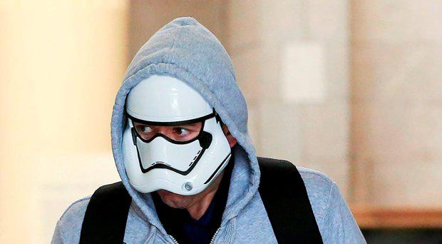 Nigel Boyne (41), an international badminton player, of Elm Mount Lawn, Beaumont, Dublin, masked and trying to hide his identity, at court