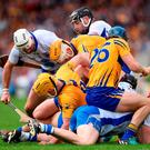 Clare and Waterford players get themselves into a tangle during Sunday's thrilling Allianz League Final replay. RAY McMANUS / SPORTSFILE