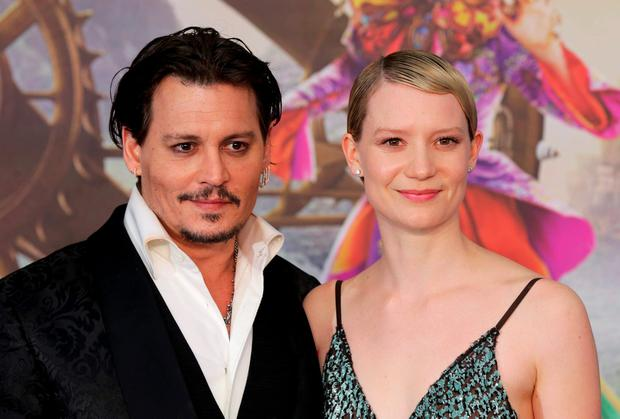 Actors Mia Wasikowska and Johnny Depp arrive at the European Premiere of Alice Through the Looking Glass at a cinema in London, Britain, May 10, 2016