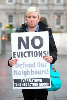 Mother-of-three Gillian Murphy from Tyrrelstown protesting outside the Dáil yesterday (Photo: Damien Eagers
