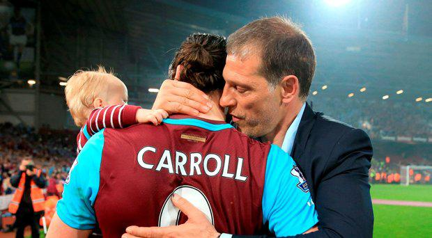 West Ham United's Andy Carroll is greeted by manager Slaven Bilic after the final whistle during the Barclays Premier League match at Upton Park, London