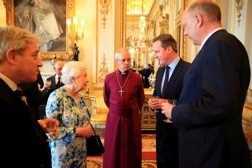 Britain's Queen Elizabeth speaks with Prime Minister David Cameron (2nd R), as Chris Grayling (R), leader of the House of Commons and Archbishop of Canterbury Justin Welby (C) watch during a reception in Buckingham Palace