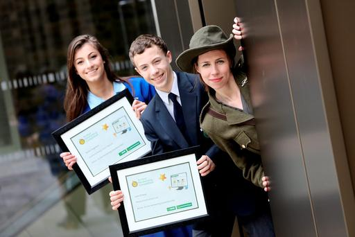 Nuala Fitzgibbon, from Ursuline Secondary School, Thurles, Co Tipperary and Liam O'Leary, Pobal Scoil na Tríonóide, Youghal, Cork with GPO Witness History performer Sarah Kinlen at the GPO. Photo Maxwells
