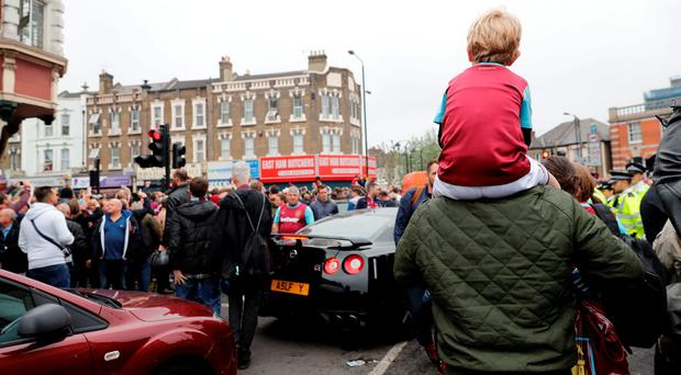 A young West Ham fan watches on as police control the crowd following a disturbance outside Upton Park. Reuters / Eddie Keogh