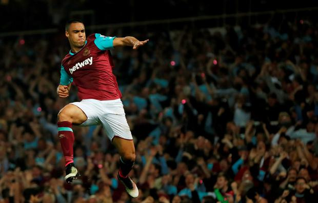 West Ham's Winston Reid celebrates scoring the Hammers' winning goal.