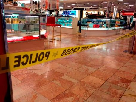 Crime scene tape is seen inside the Macy's at the Silver City Galleria mall in Taunton, Mass., Tuesday (Charles Winokoor/The Daily Gazette via AP)