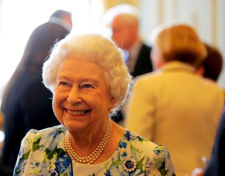 Queen Elizabeth II smiles during a reception in Buckingham Palace, London, to mark her 90th birthday Credit: Paul Hackett/PA Wire