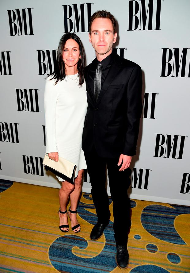 Actress Courteney Cox (L) and musician Johnny McDaid of Snow Patrol attend The 64th Annual BMI Pop Awards, honoring Taylor Swift and songwriting duo Mann & Weil, at the Beverly Wilshire Four Seasons Hotel on May 10, 2016 in Beverly Hills, California. (Photo by Frazer Harrison/Getty Images for BMI)