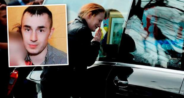 Angeline Power kisses the hearse of her partner Martin O'Rourke